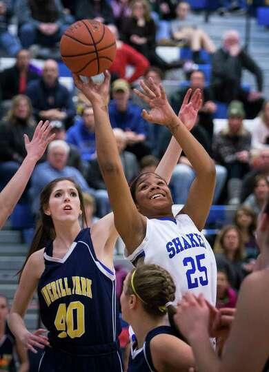 Shaker's #25 Lyric Artis puts up a jump shot during the girls' basketball game against Averill Park