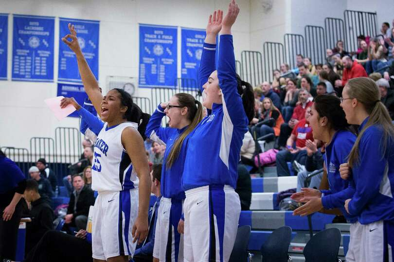 The Shaker bench reacts to a three point shot made during the girls' basketball game against Averill