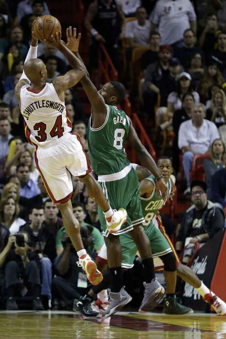 "Miami's Ray Allen (34), wearing his nickname ""J. Shuttlesworth"" jersey, shoots against Boston's Jeff Green. Photo: Alan Diaz / Associated Press / AP"