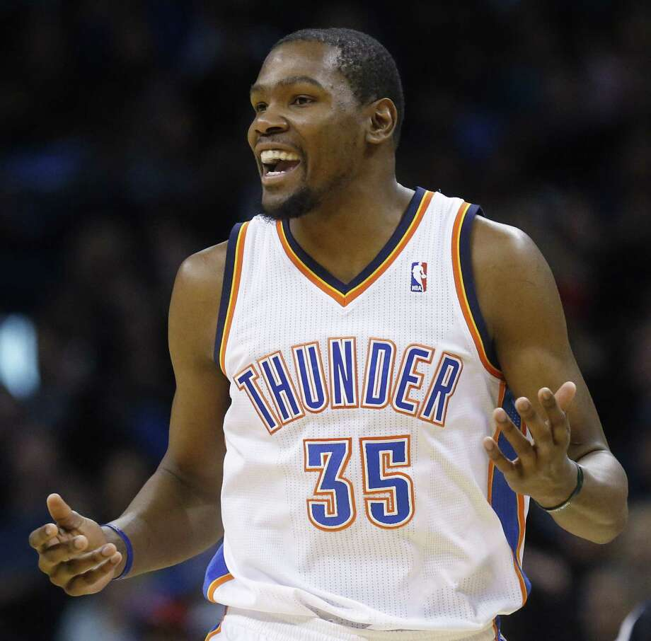 A happy Oklahoma City star Kevin Durant heads up court after scoring during the second quarter. Photo: Sue Ogrocki / Associated Press / AP