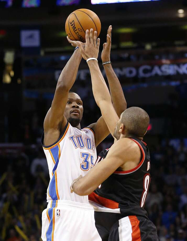 Oklahoma City's Kevin Durant gets ready to launch a shot over Portland's Nicolas Batum. Photo: Sue Ogrocki, Associated Press
