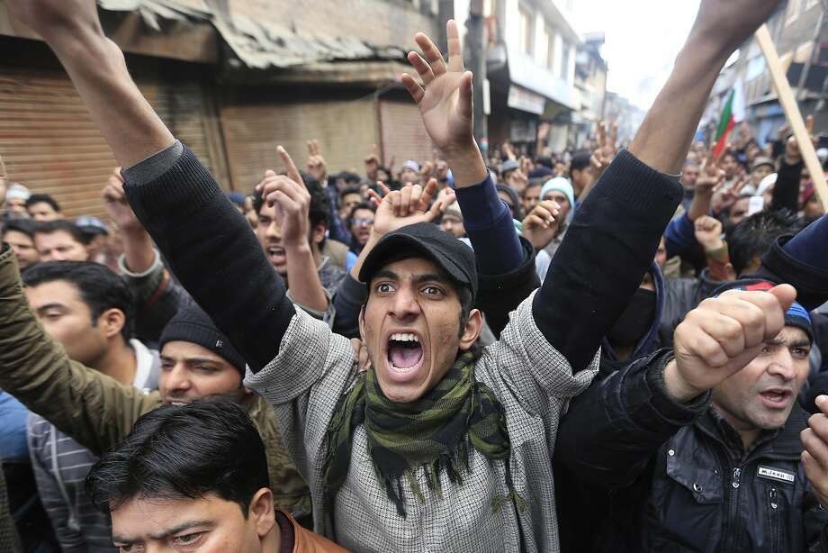 Supporters of Jammu Kashmir Liberation Front (JKLF) chairman Yasin Malik shout slogans during a memorial service to mark the anniversary of an alleged massacre in Srinagar, India, Tuesday, Jan. 21, 2014. People in the valley allege that Indian security forces opened indiscriminate fire on thousands of peaceful demonstrators near Gaw Kadal in Srinagar, killing more than 50 people 24 years ago. (AP Photo/Dar Yasin) Photo: Dar Yasin, Associated Press