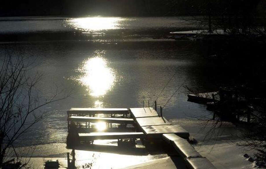 The early-winter sun glistens over a dock on Candlewood Lake in New Milford. Dec. 16, 2013 Photo: Carol Kaliff / The News-Times