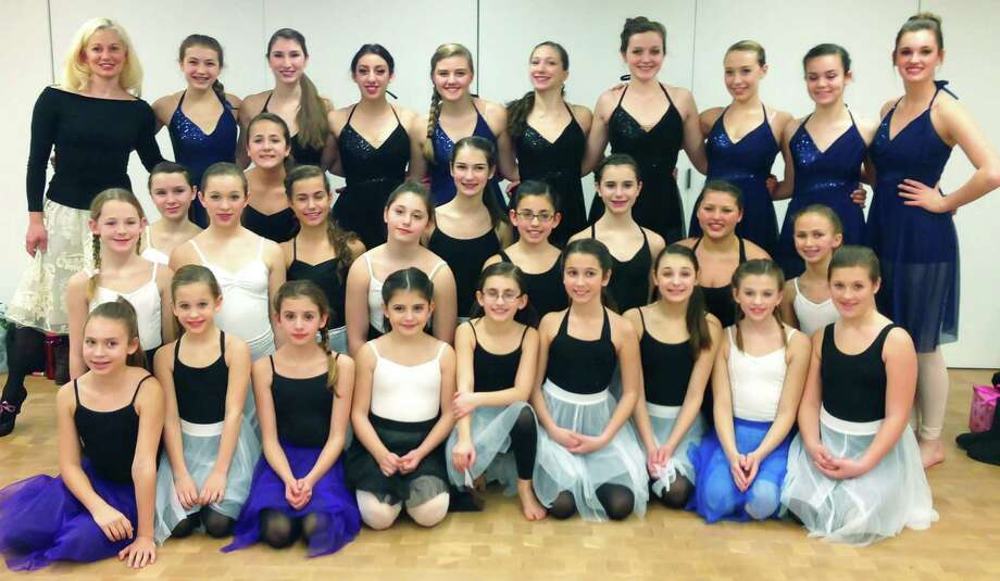 Dancers and instructors from the Studio D dance school in New Milford pose for a keepsake photo while preparing for their Jan. 18 performance at Carnegie Hall in New York City. Contributing their talents to Studio D's efforts were, from left to right, front row, Sydney Santos, 11, New Milford; Samantha Hawley, 8, Bridgewater; Katie Lukens, 11, New Milford; Gigi Esposito, 9, New Milford; Amanda Tesoriero, 10, New Milford; Ashley Johanson, 9, New Milford; Allie Prontelli, 12, New Milford; Katie Hawley, 10, Bridgewater;  and Haylie Lasky, 10, Roxbury; second row, Lindsey Federowicz, 10, New Milford; Elizabeth Hawley, 12, Bridgewater; Carolyn Gevinski, 13, New Milford; Alexa Esposito, 12, New Milford; Lindsey Johanson, 13, New Milford; Emmie Tesoriero, 11, New Milford; Gabriella Esposito, 13, New Milford; Micayla Flynn, 13, New Milford; and Anna Silva, 11, New Milford; third row, Emily Smeriglio, 13, New Milford and Julia Venezia, 13, New Milford; fourth row, Rebecca Anderson Darling, director; Juliana Zaharevich, 14, Litchfield; Rebecca Johanson, 16, New Milford; Maxine Parsons, director's assistant; Cori Paquin, 16, New Milford; Lea Krebs, 16, New Milford; Alexis Yancoskie, 17, New Milford; Kendall Ross, 16, Washington; Caroline Johnson, 14, Kent; and Alexa Sullivan, 17, New Milford. January 2014  Courtesy of Jenny Lukens Photography Photo: Contributed Photo / The News-Times Contributed