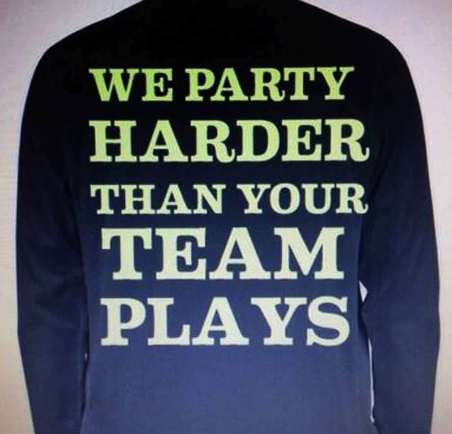 "A T-shirt worn recently by many students at New Milford High School in school and at basketball games reads ""We Party Harder Than Your Team Plays."" January 2014 Photo: Contributed Photo / The News-Times Contributed"