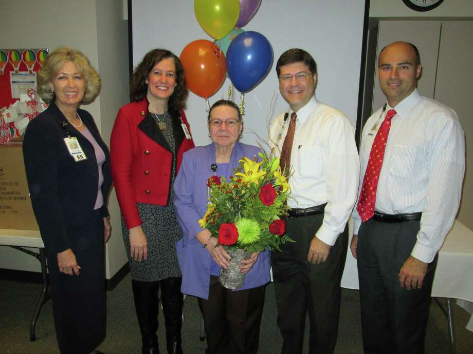 Memorial Hermann Northeast Employee of the Year Belinda Staley, center, is congrtulated by administrative team, from left, Linda Stephens, Rebecca Tucker, Louis Smith and Heath Rushing. Photo: Courtesy Of Memorial Hermann Northeast