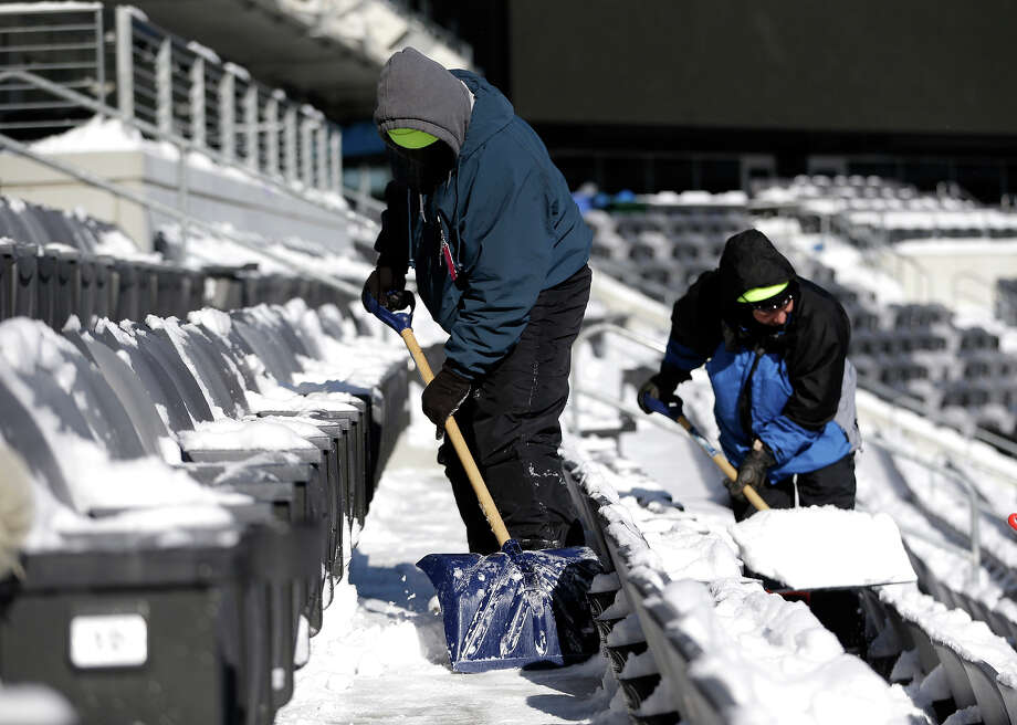 Workers shovel snow off the seates at MetLife Stadium as crews removed snow ahead of Super Bowl XLVIII following a snow storm, Wednesday, Jan. 22, 2014, in East Rutherford, N.J. Super Bowl XLVIII, which will be played between the Denver Broncos and the Seattle Seahawks on Feb. 2, will be the first NFL title game held outdoors in a city where it snows. Photo: Julio Cortez, AP / AP