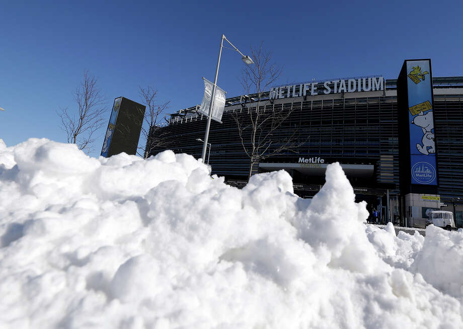 Snow is accumulated near an entrance to MetLife Stadium following a snow storm, Wednesday, Jan. 22, 2014, in East Rutherford, N.J. The NFL football title game, held Feb. 2, will be the first Super Bowl held outdoors in a city where it snows. Super Bowl XLVIII, which will be played between the Denver Broncos and the Seattle Seahawks on Feb. 2, will be the first NFL title game held outdoors in a city where it snows. Photo: Julio Cortez, AP / AP