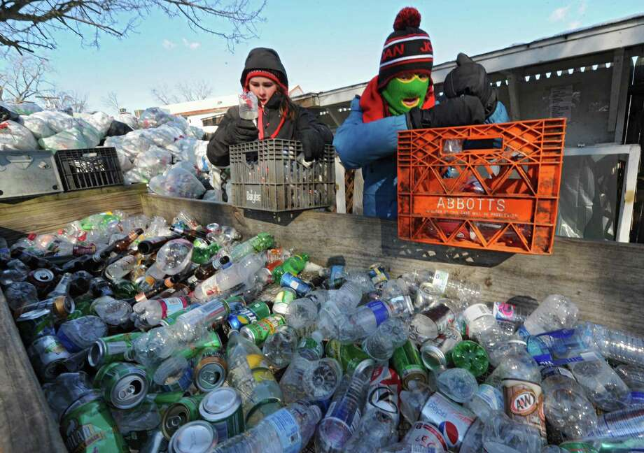Emma Willard students Heidi Dehnert, 16, left, and Olivia Kibrick, 16, sort bottles for recycling at the Mohawk Hudson Humane Society on Wednesday, Jan. 22, 2014 in Menands, N.Y. The entire 328-member student body at Emma Willard School and 55 of its teachers are spending the school day performing acts of community service throughout the Capital Region. (Lori Van Buren / Times Union) Photo: Lori Van Buren / 00025454A