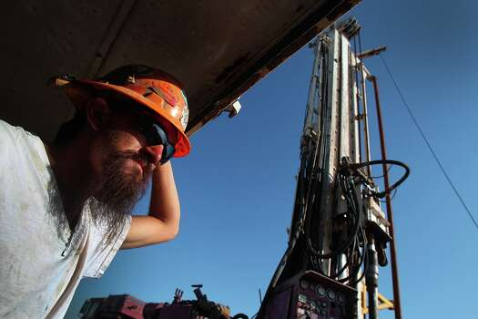 Driller Paul Allison operates the independent Barrett Brothers Number 1 drilling rig in Presideo County between Alpine and Marfa, Texas. Photo: JOHN DAVENPORT, SAN ANTONIO EXPRESS-NEWS / ©San Antonio Express-News/Photo may be sold to the public