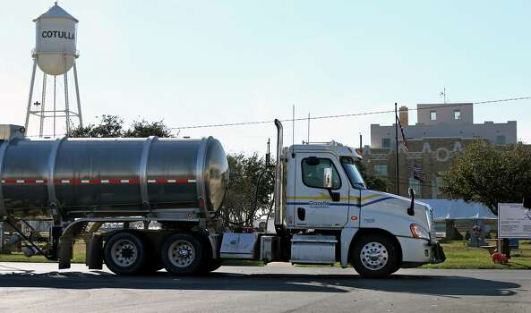 A transport tanker cruises through the downtown area  in Cotulla on January 26, 2013. Photo: Tom Reel, San Antonio Express-News / ©2012 San Antono Express-News