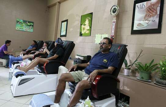 Joe Morin, manager of Star Inn in Karnes City, waits for a pedicure at the Kenedy Beauty Salon Nail and Spa in Kenedy on Tuesday, June 25, 2013. Photo: Kin Man Hui, San Antonio Express-News / ©2013 San Antonio Express-News