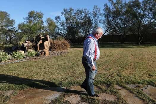 George Kowalik, 68, walks over to check out his great-great-grandfather'Äôs 1860'Äôs house on his property in Panna Maria, Texas on Tuesday, Dec. 17, 2013. Kowalik retired three years ago from a career with the Farm Bureau and until recently, scraped by with the ranching business. That changed with the oil boom. 'ÄúThere had never been any kind of oil income or any other kind of income other than farming and ranching here before. It goes back to 1854,'Äù Kowalik said. Photo: Jerry Lara, San Antonio Express-News / ©2013 San Antonio Express-News
