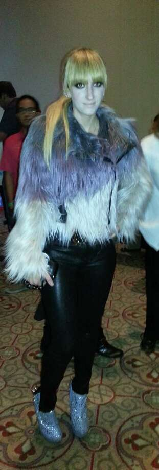 Meredith Weaver was ready to party at the San Antonio Cocktail Conference Friday night. Decked out in rocker-chic garb - how amazing is that faux fur moto jacket? - Weaver kept it all in proportion with a skinny pant and towering glitter-ball booties. Ms. Weaver, we salute you. 