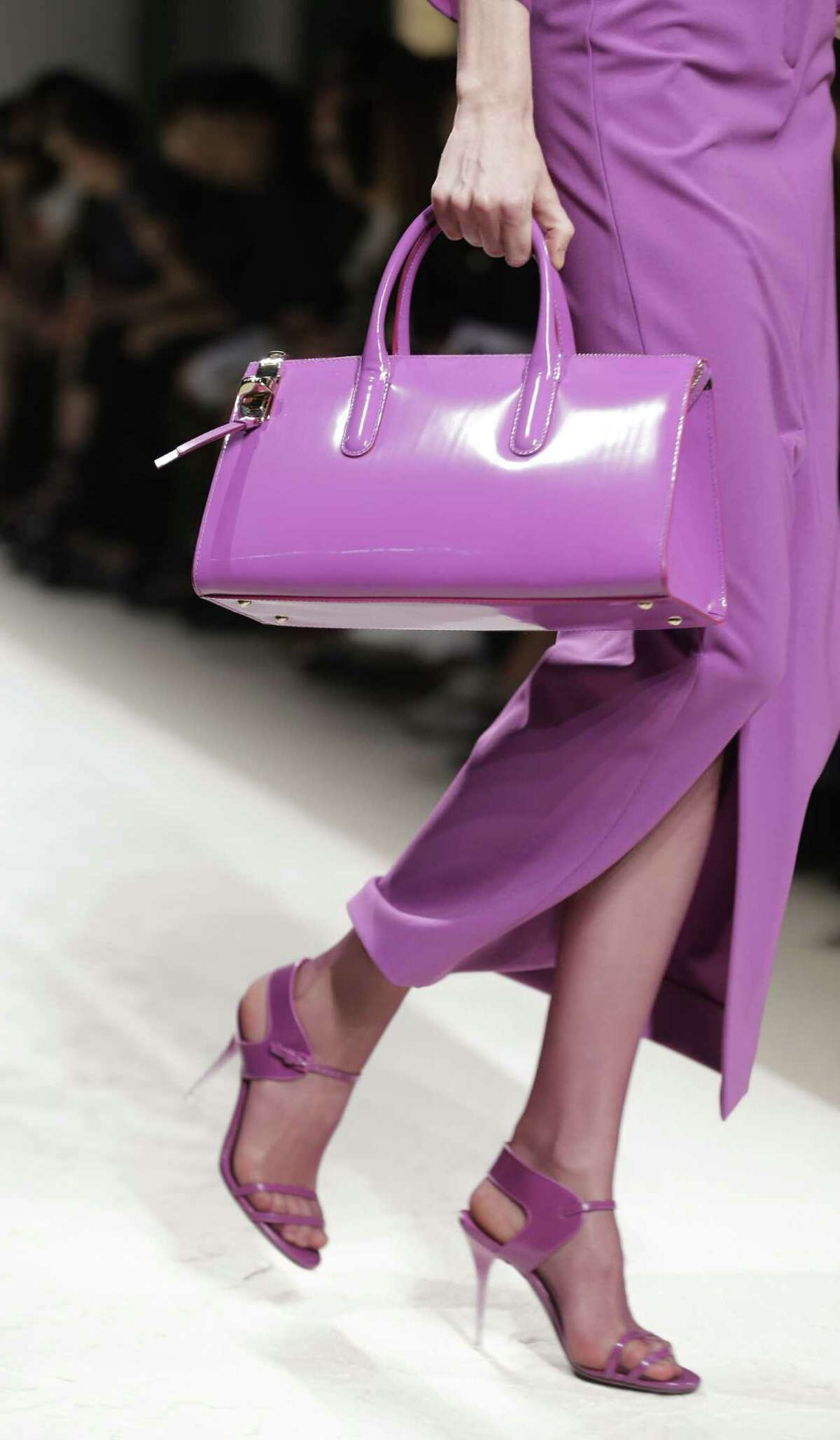 A version of Radiant Orchid highlights the Max Mara women's Spring-Summer 2014 collection. Expect to see this