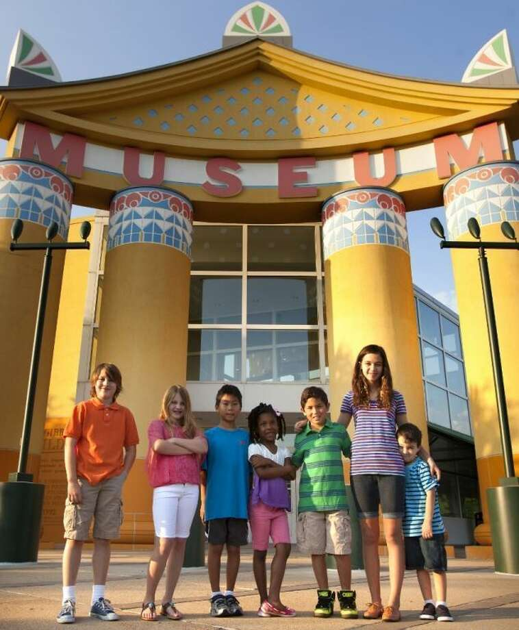 Hunter Cudini, left, Paris Cudini, Tyler King, Kiara Evans, Grisha Ross, Lily Trujillo and Nathan Maszurkewicz take a break from a visit to the Children's Museum of Houston. 