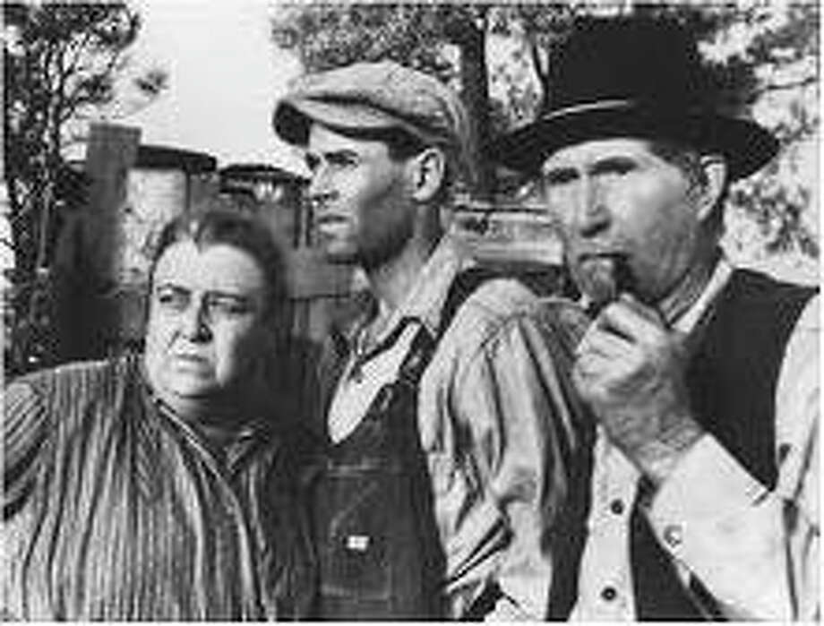Henry Fonda, center, is pictured in a scene from the film version of The Grapes of Wrath. Photo: Contributed Photo, ST / The News-Times Contributed
