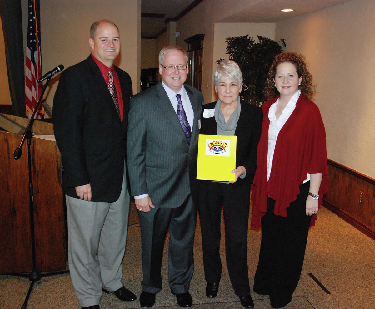 From left, Mark Henry, Eric Smith, Pam Scott and Leslie Martone celebrate PBK's recognition as a BEST business.