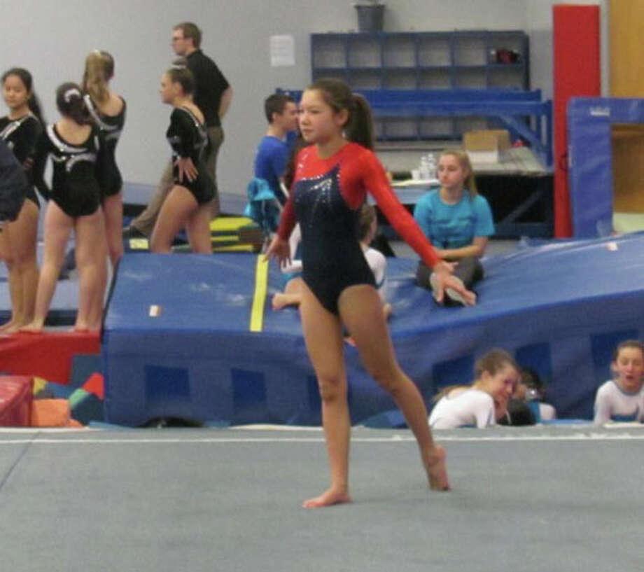 Darien YMCA House Team Level 4 gymnast Katie Weinberg competes on floor at the Lakewood-Trumbull YMCA. Photo: Contributed Photo, Contributed / Darien News