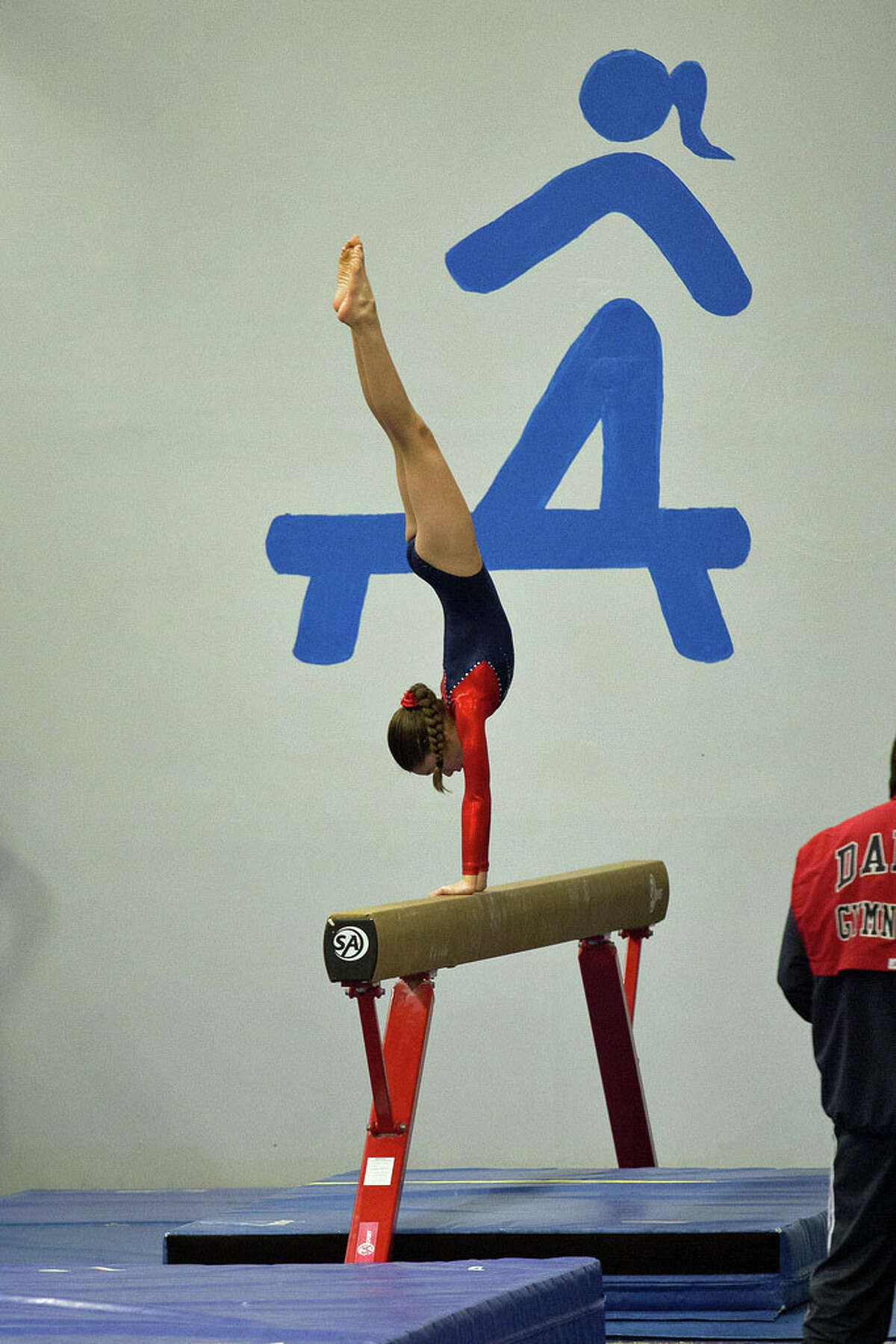 Performing on beam is Darien YMCA Level 3 House Team gymnast Sofia Imbrogno.