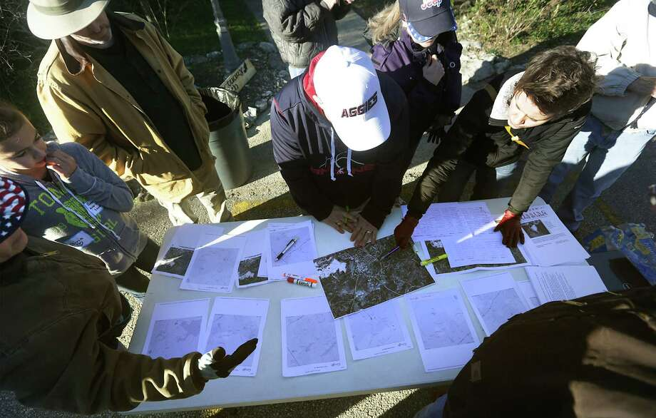 Volunteers surround a table of area maps to search in Garden Ridge close to where Leanne Bearden was last seen.  She has been missing since Jan. 17. Forty four volunteers signed up at Covenant Baptist Church for the search organized by friends and family members.  Wednesday, Jan. 22, 2014. Photo: Bob Owen, San Antonio Express-News / ©2013 San Antonio Express-News