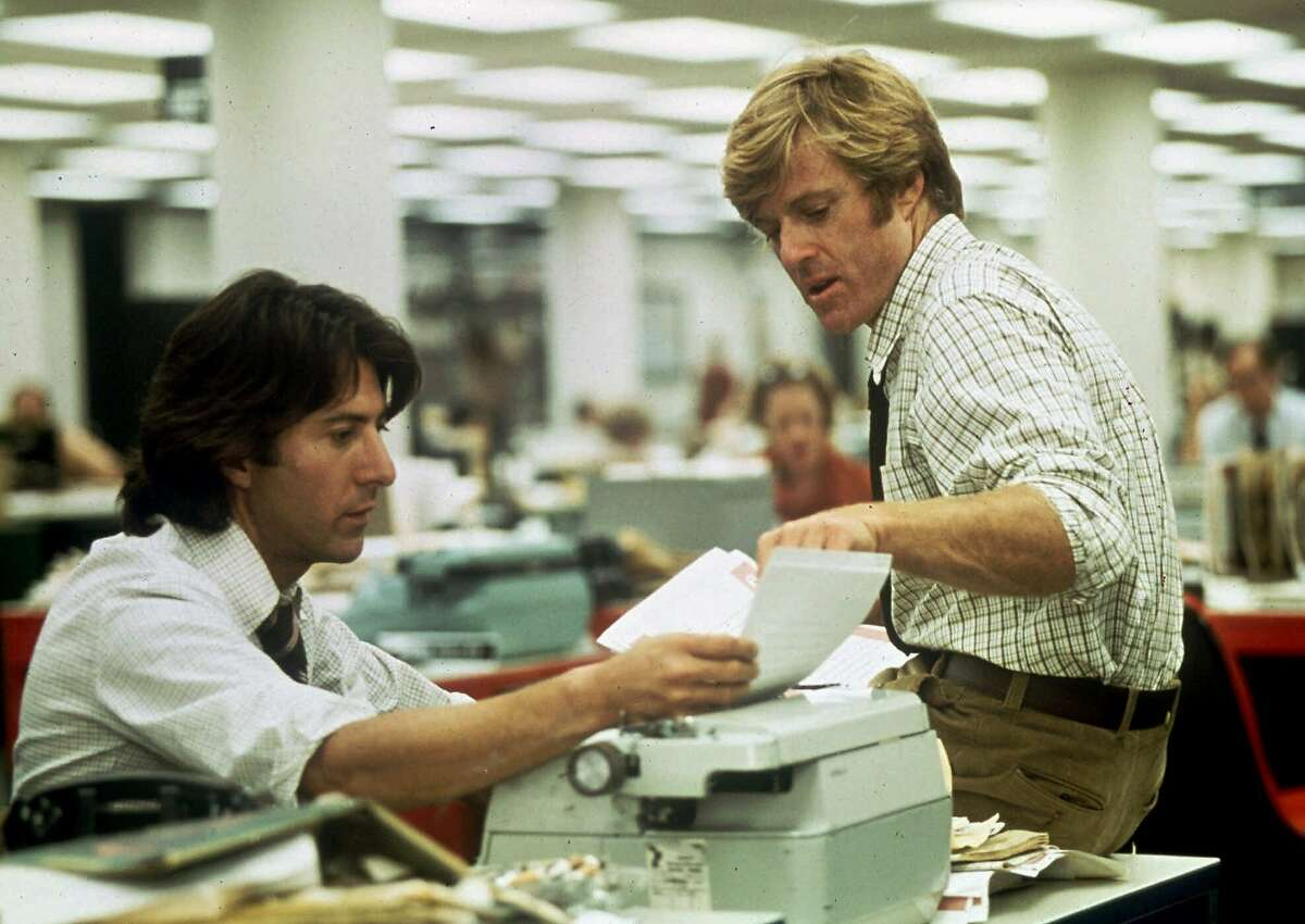 """FILE--Robert Redford, right, and Dustin Hoffman portray Washington Post reporters Bob Woodward and Carl Bernstein in the movie, """"All the President's Men."""" Alan Pakula, who directed the films ``Klute'' and ``All The President's Men,'' died Thursday Nov. 19, 1998 in a car accident at the age of 70. Pakula was driving on the Long Island Expressway when a metal pipe crashed through the windshield, striking him in the head, said Suffolk County Police spokesman Officer Santo DiStefano. (AP Photo/file)"""