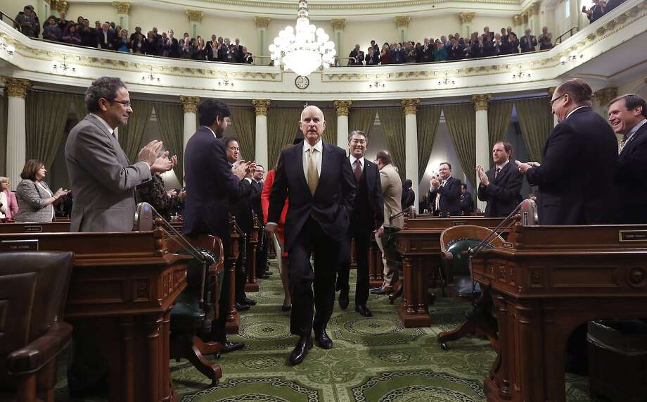 Gov. Jerry Brown receives applause from lawmakers as he walks to podium of the Assembly chambers to deliver his State of the State address at the Capitol in Sacramento, Calif., Wednesday, Jan. 22, 2014. Brown delivered a dual message in his annual address to the Legislature, that a California resurgence is well underway but is threatened by economic and environmental uncertainties. Photo: Rich Pedroncelli, Associated Press