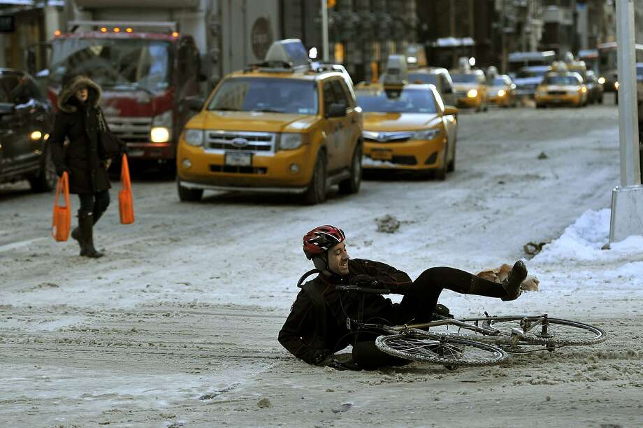 A foot of new snow didn't keep this man from riding his bike on the icy streets. Maybe not the wisest decision, but we admire the audacity. Photo: Timothy Clary, AFP/Getty Images
