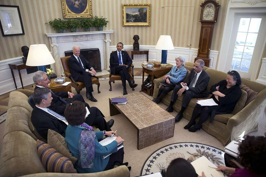 Vice President Joe Biden (center left) and President Obama meet with members of the Council on Women and Girls. Photo: Doug Mills, New York Times