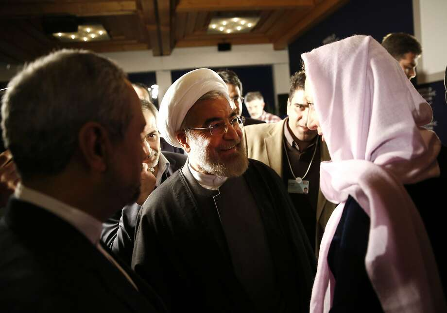 Hassan Rouhani, Iran's president, center, speaks with Francine Lacqua, editor at large and anchor for Bloomberg Television, right, following an interview on the opening day of the World Economic Forum (WEF) in Davos, Switzerland, on Wednesday, Jan. 22, 2014. World leaders, influential executives, bankers and policy makers attend the 44th annual meeting of the World Economic Forum in Davos, the five day event runs from Jan. 22-25. Photographer: Simon Dawson/Bloomberg *** Local Caption *** Hassan Rouhani; Francine Lacqua Photo: Simon Dawson, Bloomberg