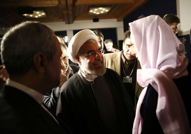 Hassan Rouhani, Iran's president, center, speaks with Francine Lacqua, editor at large and anchor fo
