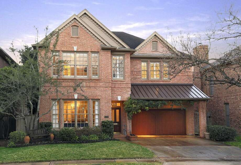 This photo showcases the home's brick exterior.