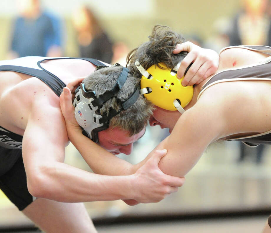 Lucas Bell of Brunswick, at right, squares off against Hackley's Dan Shaw in the 152 pound match during the Brunswick School Invitational Wrestling Tournament at the school in Greenwich, Saturday, Jan. 18, 2014. Photo: Bob Luckey / Greenwich Time