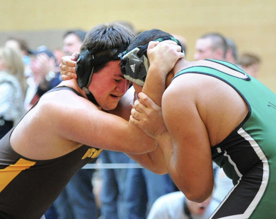Brett Adamo of Brunswick, left, goes up against Hamden Hall's Jordan Gifford during the 220 pound weight class match in the Brunswick School Invitational Wrestling Tournament at the school in Greenwich, Saturday, Jan. 18, 2014. Photo: Bob Luckey / Greenwich Time