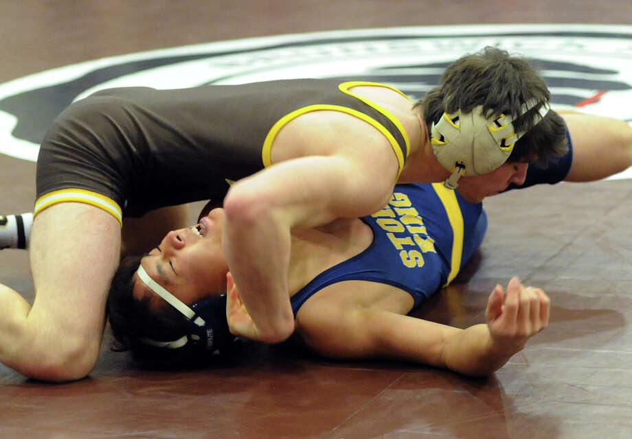 Brunswick School wrestler Jimmy Bell gets the better of Taehan Lee of the Storm King School to win the championship match in the 134 pound weight class during the Brunswick Invitational Wrestling Tournament at the school in Greenwich, Saturday, Jan. 18, 2014. Photo: Bob Luckey / Greenwich Time