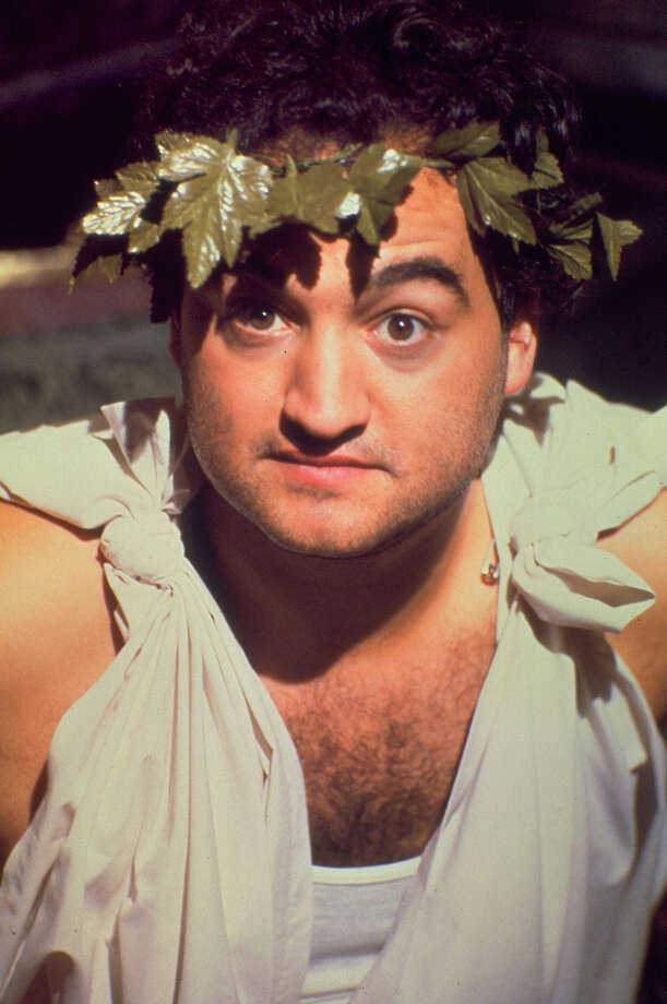 "This undated  photo released by Universal Studios Home Entertainment, shows actor John Belushi in a scene from the 1978 film ""Animal House."" When a force of nature like Belushi is lost, 25 years isn't time enough to ease the grief or erase the laughter. (AP Photo/NBC) / UNIVERSAL STUDIOS HOME ENTERTAIN"