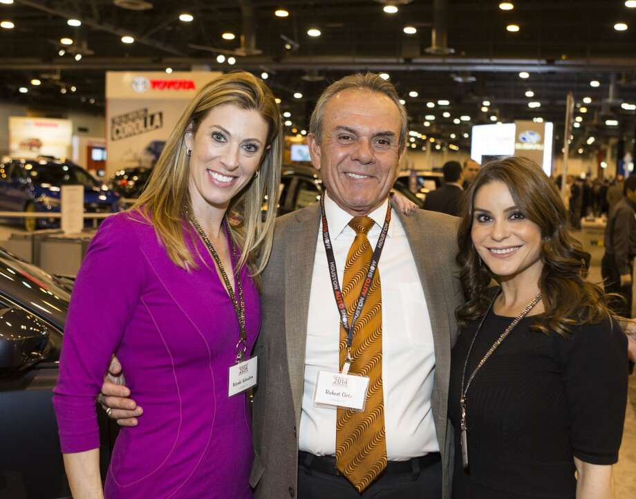 Nicole Winston, left, Robert Getz, center, and Michelle Zamora attend the Houston Auto Show's 30th Anniversary Preview Party Tuesday, Jan. 21, 2014, in Houston. ( Nick de la Torre