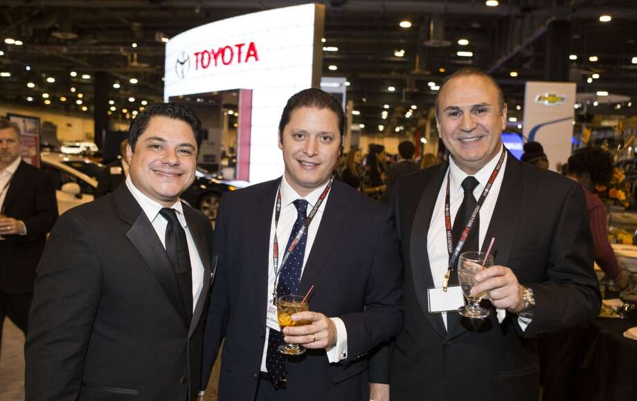Javier Chavez, left, Sebastian Abraham, center, and Danny Gonzalez attend the Houston Auto Show's 30th Anniversary Preview Party Tuesday, Jan. 21, 2014, in Houston. ( Nick de la Torre