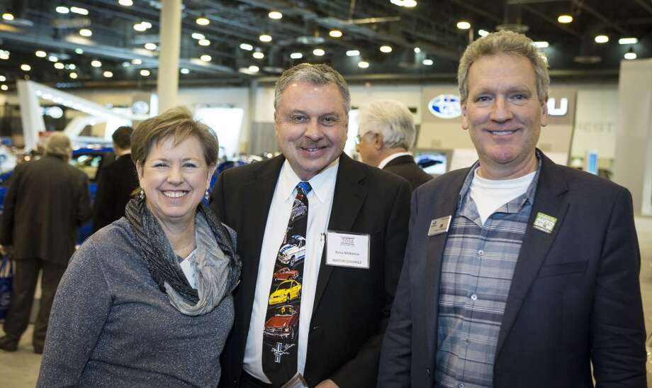 Carol McKenzie, left, Steve McKenzie, center, and Jon Mulkey attend the Houston Auto Show's 30th Anniversary Preview Party Tuesday, Jan. 21, 2014, in Houston. ( Nick de la Torre