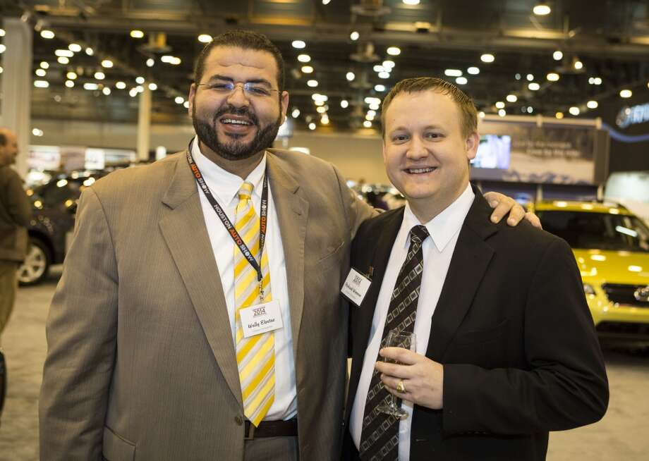 Wally Elostaz, left, and Richard Woerner attend the Houston Auto Show's 30th Anniversary Preview Party Tuesday, Jan. 21, 2014, in Houston. ( Nick de la Torre