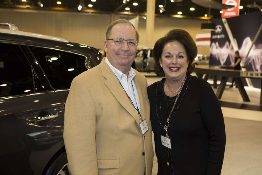 Mike and Susan Carlson attend the Houston Auto Show's 30th Anniversary Preview Party Tuesday, Jan. 21, 2014, in Houston. ( Nick de la Torre