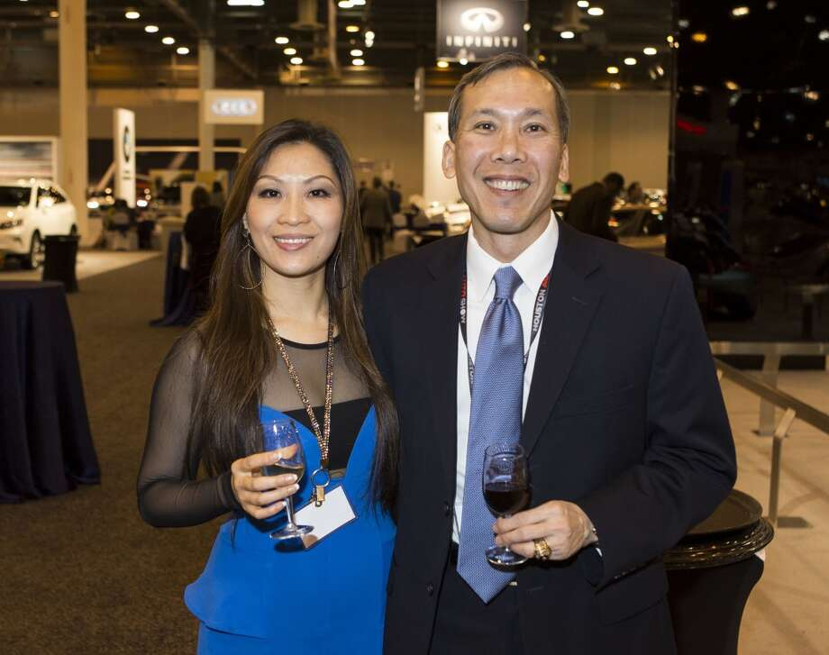 Summer Song, left, and Mike Wong attend the Houston Auto Show's 30th Anniversary Preview Party Tuesday, Jan. 21, 2014, in Houston. ( Nick de la Torre