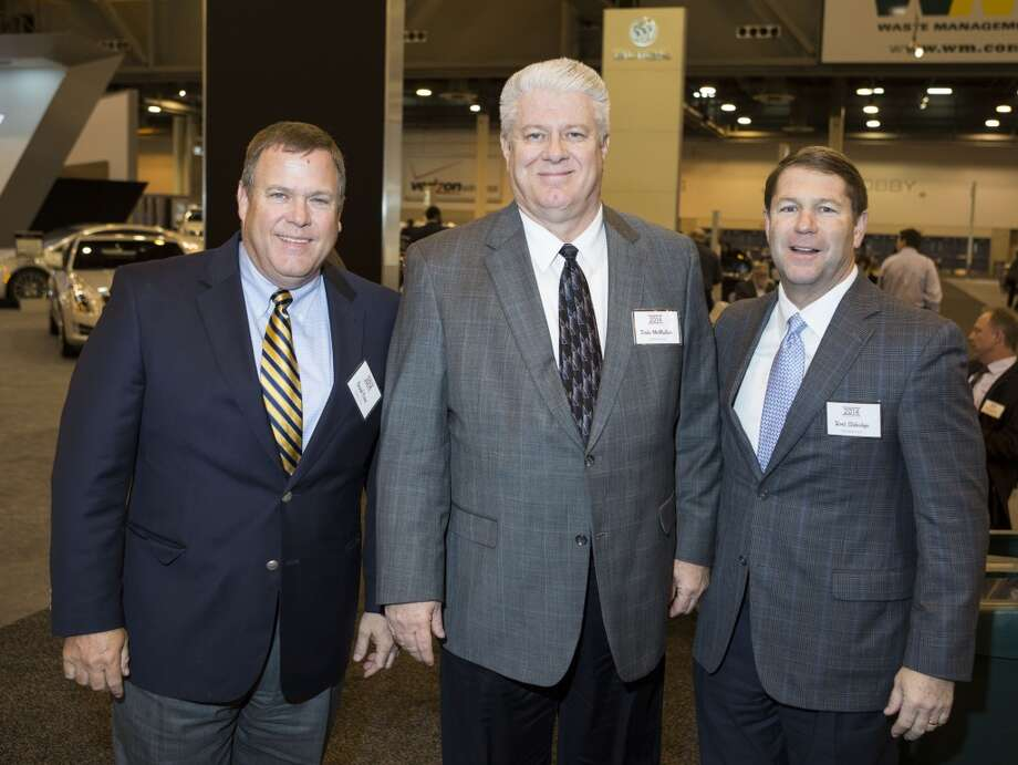 David Trice, left, Dale McMullen, center, and Bret Aldridge attend the Houston Auto Show's 30th Anniversary Preview Party Tuesday, Jan. 21, 2014, in Houston. ( Nick de la Torre