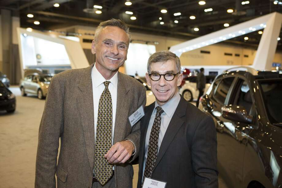 Mark Siurek, left, and Scott Sawyer attend the Houston Auto Show's 30th Anniversary Preview Party Tuesday, Jan. 21, 2014, in Houston. ( Nick de la Torre