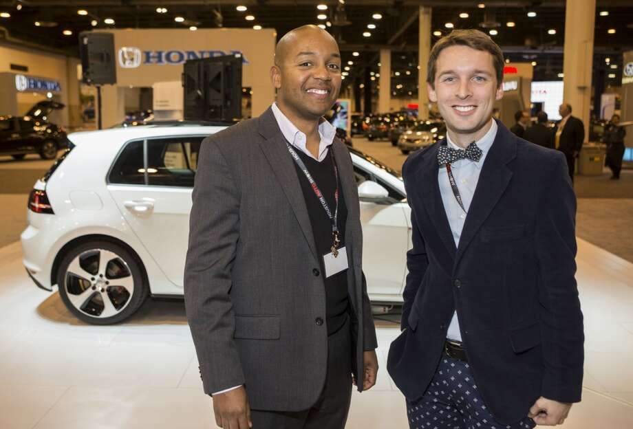 Darryll Harrison, left, and Nic Phillip attend the Houston Auto Show's 30th Anniversary Preview Party Tuesday, Jan. 21, 2014, in Houston. ( Nick de la Torre