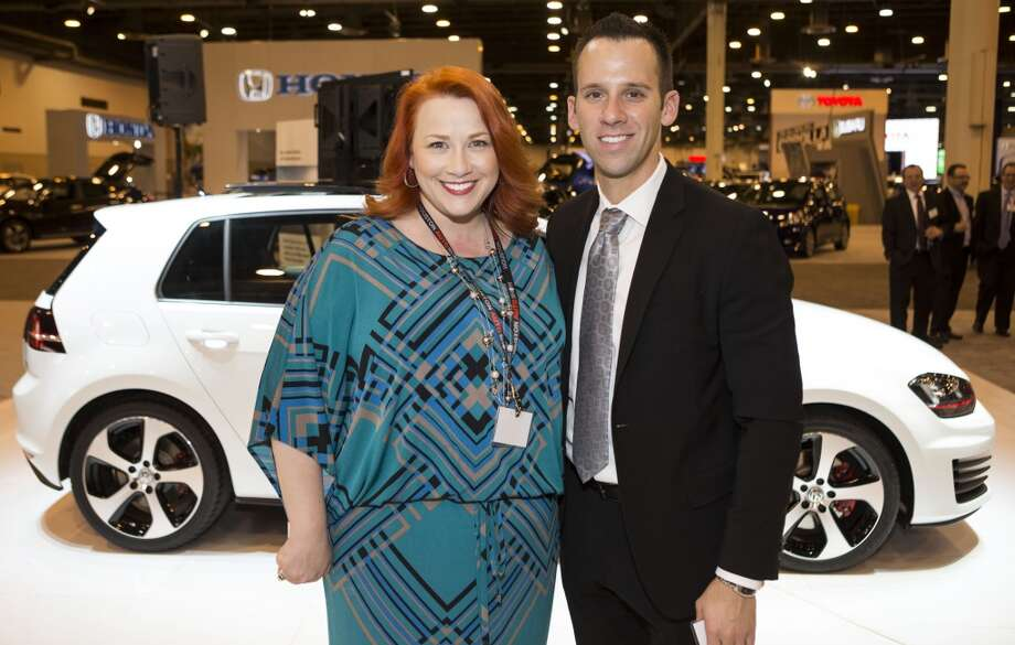 Jamie Brooks, left, and David Telfer attend the Houston Auto Show's 30th Anniversary Preview Party Tuesday, Jan. 21, 2014, in Houston. ( Nick de la Torre