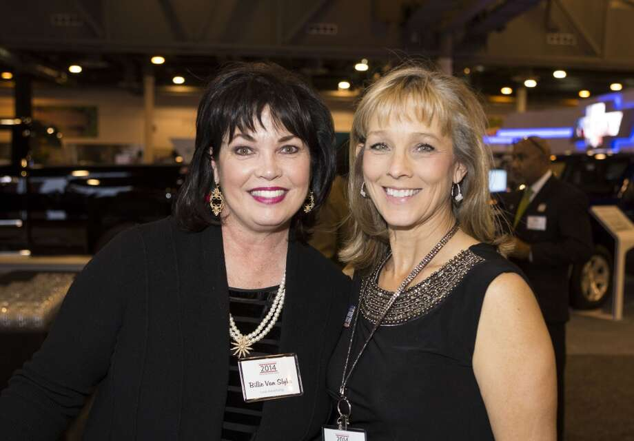 Billie Van Slyke, left, and Jamie Wainwright attend the Houston Auto Show's 30th Anniversary Preview Party Tuesday, Jan. 21, 2014, in Houston. ( Nick de la Torre