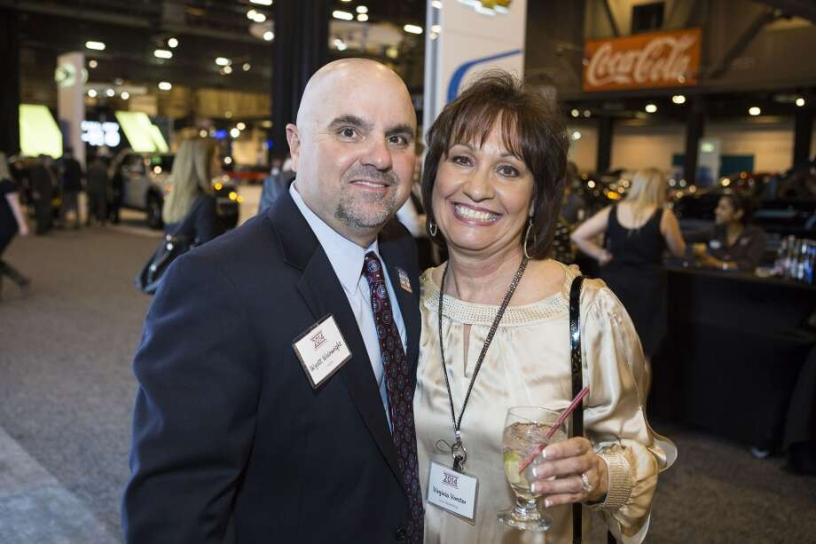Wyatt Wainwright, President of the Houston Auto Dealers Association, left, and Virginia Vorster attend the Houston Auto Show's 30th Anniversary Preview Party Tuesday, Jan. 21, 2014, in Houston. ( Nick de la Torre