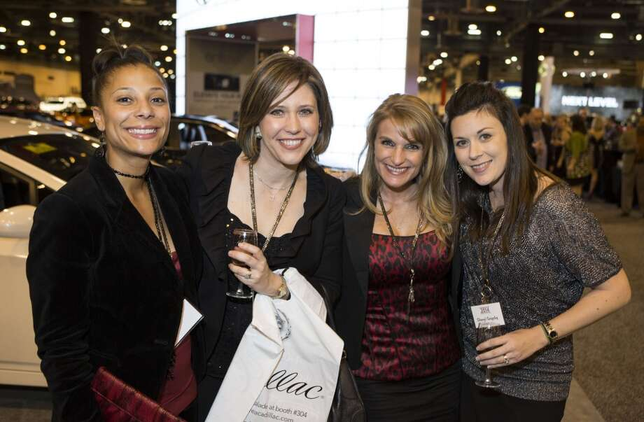 Left to right; Alana Thomas, Laura Filippone, Crissy Worrell, and Sheryl Grigsby attend the Houston Auto Show's 30th Anniversary Preview Party Tuesday, Jan. 21, 2014, in Houston. ( Nick de la Torre