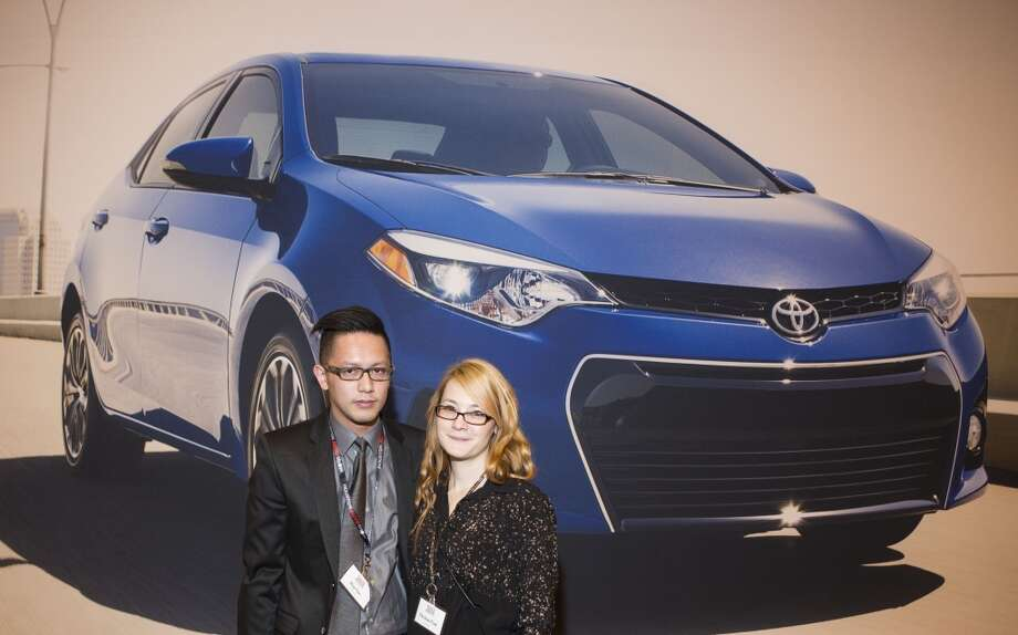 Huy Cao, left, and Christine Ford attend the Houston Auto Show's 30th Anniversary Preview Party Tuesday, Jan. 21, 2014, in Houston. ( Nick de la Torre